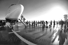 Waiting to board the plane (alison laredo) Tags: ireland blackandwhite bw sun tarmac plane airplane airport shadows aeroplane apron queue mayo standinginline waitingtoboard