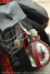 potion: Bristol Ren Faire (Jen's Photography) Tags: accessories romantic leatherwork maroon object period define dictionary word meaning words black knight leather actor costume bristolrenaissancefestival ren fair fest festival kenoshawisconsin kenosha wisconsin september laborday holiday roadtrip summer 2010 d80 nikon jensphotography potion bottle flask glass pouch bags medieval fairytale