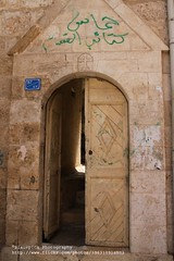 Bethlehem, Church entry with Muslim graffiti (blauepics) Tags: door city houses west church architecture graffiti palestine westbank eingang muslim faith religion kirche bank east stadt architektur historical tor middle bethlehem osten tr palstina entry territory beit huser palestinian historisch glaube westjordanland lehem mittlerer