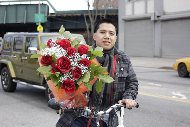 Bouquet-bearing bicyclist, Brighton Beach, Brooklyn