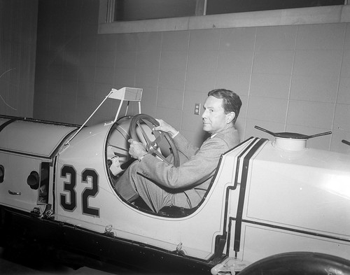 Tony Hulman sits in the Marmon Wasp in 1956
