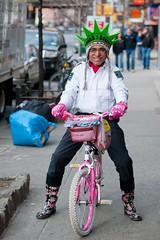 Manhattan's Mad Hatter (Packing-Light) Tags: street nyc pink portrait newyork bicycle liberty costume boots manhattan gotham hellskitchen thebigapple