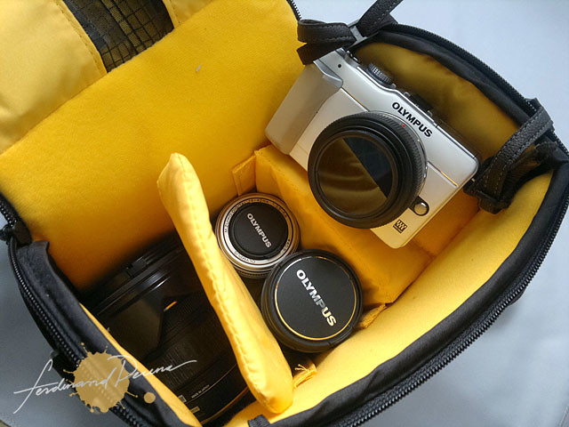 The main compartment can fit my Olympus PEN, 3 more lenses and filters