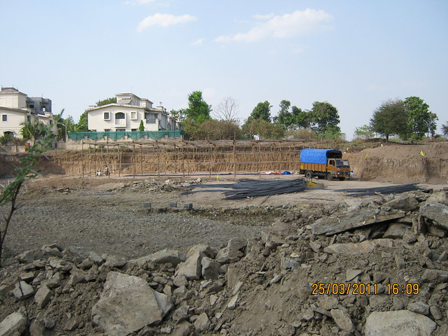 Bungalows in Prathamesh Park in the background and the excavated site of DSK Gandhakosh Baner Pune in the foreground