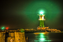 the green light (bocero1977) Tags: lighthouse warnemnde corona wooden water germany mood outdoor balticsea stones light lights longexposure perspective seascape night rocks lines sky green fineart reflection colors sea
