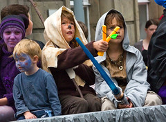 boys will be... (Argon X) Tags: carnival kids naughty play faces streetphotography acting imagination characters mischief slingshot catapult lightsabre paintedfaces blacknose