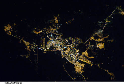 "Brasilia, Brazil at Night (NASA, International Space Station, 01/08/11) <i>Editors Note: This is part of a larger Flickr set, ""NASA Views Earth at Night,"" located here: <a href=""http://www.flickr.com/photos/28634332@N05/sets/72157625188331491/"">www.flickr.com/photos/28634332@N05/sets/72157625188331491/</a> </i>  Brasilia, Brazil at night time is featured in this image photographed by an Expedition 26 crew member on the International Space Station. Whether seen at night or during the day, the capital city of Brazil is unmistakable from orbit. Brasilia is located on a plateau (the Planalto Central) in the west-central part of the country, and is widely considered to be one of the best examples of 20th century urban planning in the world. One of its most distinctive design features-as seen from above-suggests a bird, butterfly, or airplane traveling along a northwest-southeast direction, and is made dramatically visible by city light patterns (center left, directly to the west of Lake Paranoa). Following the establishment of Brasilia in the early 1960s informal settlements began to form around the original planned city. Ceilandia, located to the west of Brasilia, was one such informal settlement. In 1970 the settlement was formalized by the government and is now a satellite city of Brasilia with its own distinct urban identity. The developed areas of Brasilia and its satellite cities are clearly outlined by street grid and highway light patterns at night in this photograph taken from the space station. The large unlit region to the northwest of the city is the Brasilia National Park (lower left); other dark regions to the south and southwest contain agricultural fields and expanses of Cerrado tropical savanna.   Image credit: NASA   View original image/caption: <a href=""http://spaceflight.nasa.gov/gallery/images/station/crew-26/html/iss026e016368.html"" rel=""nofollow"">spaceflight.nasa.gov/gallery/images/station/crew-26/html/...</a>  More about space station research: <a href=""http://www.nasa.gov/mission_pages/station/research/index.html"" rel=""nofollow"">www.nasa.gov/mission_pages/station/research/index.html</a>  Theres a Flickr group about Space Station Research. Please feel welcome to join! <a href=""http://www.flickr.com/groups/stationscience/"">www.flickr.com/groups/stationscience/</a>"