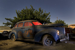 The Shaggy Commander (Lost America) Tags: lightpainting night 1940 fullmoon studebaker junkyard commander nocturnes thebigm