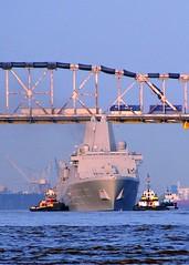 USS New York passes under the Huey P. Long Bridge (ussnewyork) Tags: newyork la unitedstates ships tug avondale underway pcu