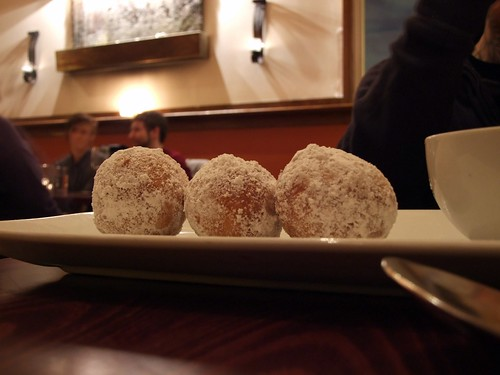 Chocolate filled beignets covered with powdered sugar.