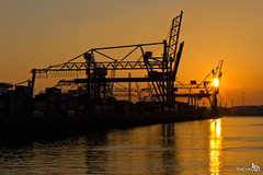 Sunset in the Port (BraCom (Bram)) Tags: chimney sun haven reflection port harbor rotterdam harbour terminal cranes container zon rst kranen spiegeling schoorsteen beatrixhaven bracom