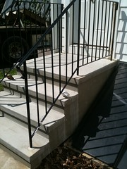 stucco steps with rails