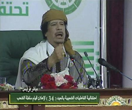 Muammar Gaddafi addresses the people's committees in Tripoli, Libya on the 34th anniversary of the establishment of the socialist system in this North African state. Gaddafi warned U.S. imperialism of a bloody war if it invaded the country. by Pan-African News Wire File Photos