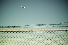 Escape (Nick Harris1) Tags: vacation plane fence compound trapped prison barbedwire smcpentaxfa31mmf18allimited