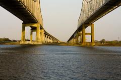Perspective on Two Bridges (storyvillegirl) Tags: bridges mississippiriver unusualperspective neworleansnola twinspan