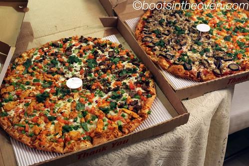 half tandoori chicken, half mutton masala pizza and half masala eggplant half paneer tikka pizza