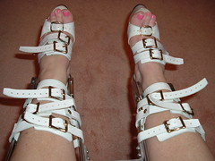 Closeup of the Ankle Strapping and High Heels (KAFOmaker) Tags: feet leather fetish foot high control legs braces lock sandals steel leg wrapped encased bondage device strap torso heel elk straight tight bound buckle locked brace restricted sandal joint buckles chained immobilized restraint restriction polio laced kafo restrained encase orthopedic imprisoned strapped heeled braced restrict buckled encircled immobilize tightly kneepad tlso tlso2