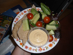 Pitta bread fingers with hummus and salad