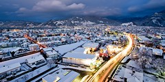 dornbirn covered in snow [EXPLORED] (Matthias Rhomberg) Tags: street city blue houses red panorama white snow mountains cars rooftop clouds landscape lights austria town dornbirn sterreich nikon view traffic terrace wide wideangle explore lighttrails bluehour vorarlberg panoramahaus d700 fourpointsbysheraton nikkor1424mmf28g homeofbalance gettysalq4