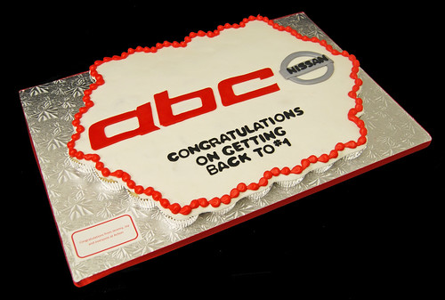 business gift from advertising agency to local car dealership - logo cupcake cake
