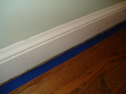 painters tape on edge of gap to protect floor