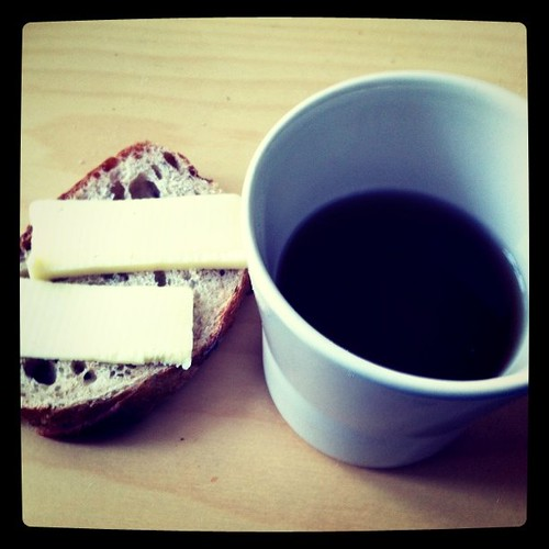 Breakfast: organic rustic bread topped with organic garlic cheese. Goes down with Golden Needle tea.