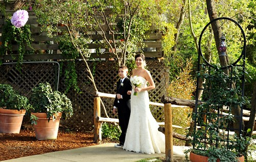 Jacob and Kelly walking down the aisle.