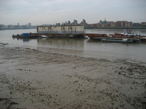 Mud and barges by the Greenwich peninsula