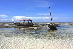 2 boats at low tide (Zanzibar) (Z Eduardo...) Tags: africa blue sky seascape beach water clouds island boat zanzibar lowtide indic rasnungwi platinumheartaward flickraward platinumpeaceaward flickraward5