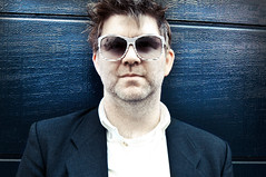 James Murphy of LCD Soundsystem (Charlotte Zoller) Tags: wood blue color sunglasses contrast suit colored nytimes blazer bluewall lcdsoundsystem centered dfa scruff studiolighting whiteshirt collaredshirt jamesmurphy dfarecords incolor tkom charlottezoller lcdsoundsystemyacht jamesmurphyportrait jamesmurphypromo