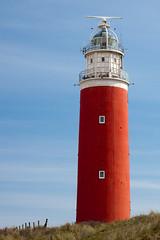 Texel lighthouse (yornik) Tags: blue red sea sky lighthouse holland building tower cloudy dune radar texel flickraward flickraward5