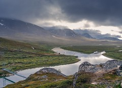 The view from Alesjaurestugorna (Hiking-Dennis) Tags: flickr lappland adventure explore trekking backpack outdoors outdoor landscape water lake hiking nature bridge rock snow reflection tundra valley noperson wildlife pleasureoftravel mountains sweden kungsleden landschaft clouds