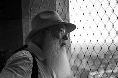 Father Christmas on holiday? (paul indigo) Tags: belfry belgium halletoren beard glasses hat man portrait tourist travel view
