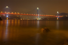 Ting Kau Bridge at Night. (Nick Atkin) Tags: longexposure blue red sea sky orange white black green water yellow architecture night clouds reflections landscape hongkong lights rocks streetlights hills tsingyi tingkaubridge canonef1635mmf28lusmmkii canon5dmkii