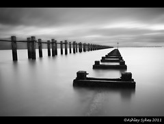 Sarfend Pier (AshMashMash) Tags: sky cloud white black beach water monochrome pier sand smooth essex southend