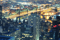 Queensboro Bridge at Night, New York City (andrew c mace) Tags: above nyc newyorkcity longexposure bridge roof urban newyork rooftop skyline night cityscape manhattan aerial midtown queens queensborobridge rooseveltisland longislandcity uppereastside silvercup 59thstreetbridge citigroupcenter 59thst 59street nikkor50mm colorefex nikoncapturenx nikond90 edkochbridge