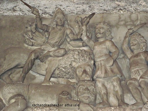 Durga fighting demons