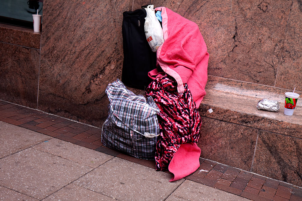 Woman-under-pink-and-red-blankets--Center-City