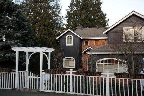 White arbor gate, fence, gray house, North Matthews Beach, Sand Point Way Uplands, Seattle, Washington, USA by Wonderlane