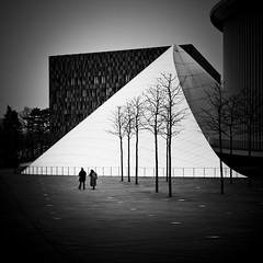 Lost in Structuration : Couple Philharmonie (Gilderic Photography) Tags: city people urban music woman white cinema man black tree architecture canon square eos couple europe raw mood pyramid structure story luxembourg cinematic luxemburg musique kirchberg lightroom philharmonie carre 500d 500x500 philarmonie gilderic superaplus aplusphoto asquaresuperstarstemple