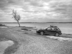 lunch break at wahoo bay (zeropsa) Tags: bw tree beach 2004 water clouds drive rocks bc subaru lone impreza wrx hdr muskogee subie lakefortgibson