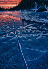 Frozen Veins of Fire (Mike Berenson - Colorado Captures) Tags: morning winter sky lake cold ice nature weather sunrise snowshoe frozen nationalpark crack vein gps allrightsreserved rockymountainnationalpark dreamlake coloradocaptures hdrefexpro copyright2011bymikeberenson