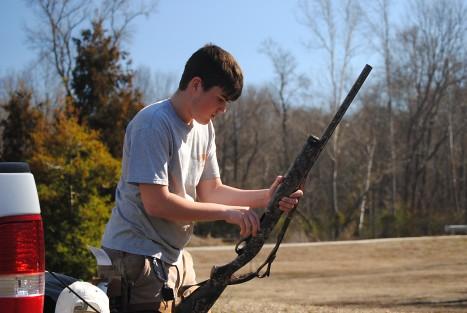 Carson workin' on his gun