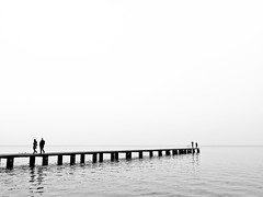 Untitled (Francesco Baldiotti) Tags: bw water walking landscape blackwhite couple almostbw award bn molo biancoenero 43 sirmione gardalake lagodigarda gardasee coppie lifeinblackwhite zuikodigital1122mm olympuse410 theauthorsplaza theauthorsclub