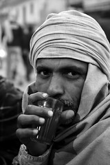Warming up with a tea (Olivier Th) Tags: voyage wood city trip morning travel winter vacation portrait people blackandwhite bw india man cold men canon beard fire eos photo asia noiretblanc tea indian hiver reporter picture culture nb ashes varanasi indians asie turban chale hindu warmup froid indien thao ville feu hommes barbe bois gens inde reportage matin ghat buche th indiens cendres tchai chal indienne republicofindia ghaat journalisme indiennes photoreportage bnars attroupement serchaufferer