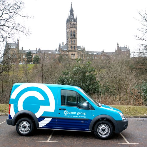 amor group. One of the Amor Group vans with the University of Glasgow in the background.