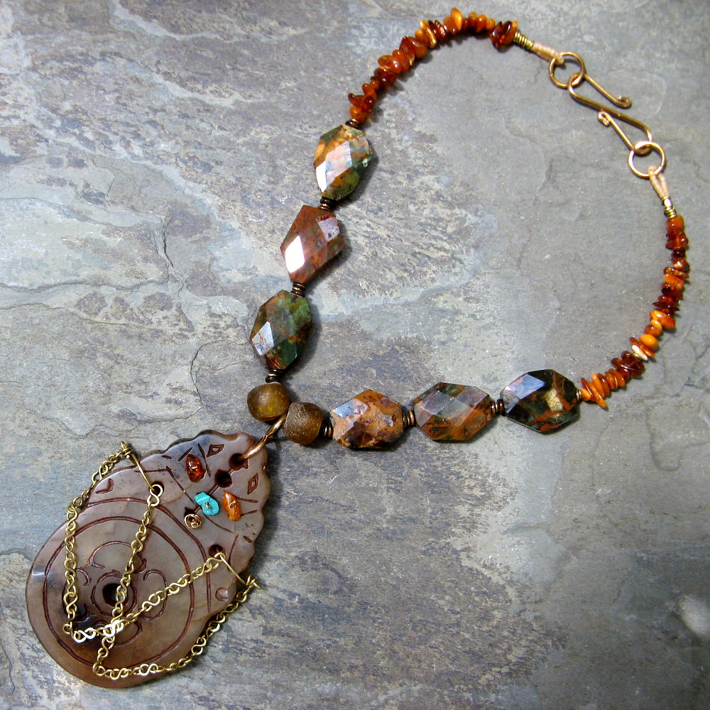 something rich and strange-- beaded stone necklace with celtic rabbit pendant and amber