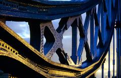 Tower Bridge, sculptured metal (Mr. Observer) Tags: uk bridge blue orange sun london art thames analog towerbridge rivets cross kodak scanner slide glowing nikonf2 ektachrome epson4990