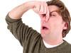 Man holding nose.jpg