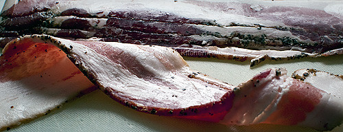 slice of raw bacon